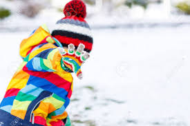 Cute Little Funny Boy In Colorful Winter Clothes Playing Fighting With Snow Ball Outdoors On
