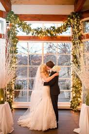 Lit Up Fir Garland Used As An Indoor Wedding Arch Is A Nice And Simple Idea