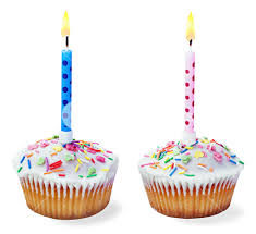 cupcakes with a birthday candle isolated on a white background
