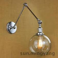 modern clear glass swing arm wall sconce adjustable wall