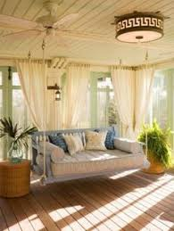 Beautiful Sun Room Decorating Idea With Hanging Chair And Drum Ceiling Light Also Wooden Floor Along White Curtains