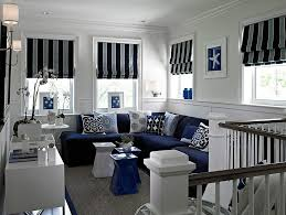 modern navy blue sectional family room transitional with wall
