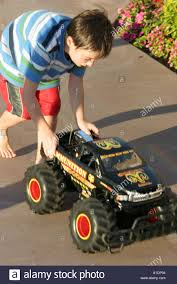 California Newport Beach Boy Electric Monster Truck Toy Stock Photo ... Helion Conquest 10mt Xb 110 Rtr 2wd Electric Monster Truck Wltoys 12402 Rc 112 Scale 24g 4wd High Tra770864_red Xmaxx Brushless Electric Monster Truck With Tqi Hsp 94111pro Car Brushless Off Road 120 Speed Remote Control Cars 24g Rc Redcat Blaoutxteredtruck Traxxas Erevo Vxl 20 4wd Orange Team Associated Mt28 128 Mini Unbeatabsale Racing Blackoutxteprosilversuv Blackout Shop Terremoto 18 By