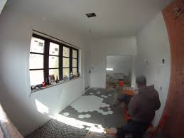 the dreamhouse project installing a hex tile floor