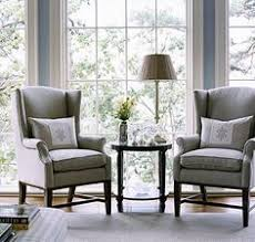Used Ethan Allen Wingback Chairs by Navy Blue Ticking Stripe Fabric Used To Create Custom Slipcovers