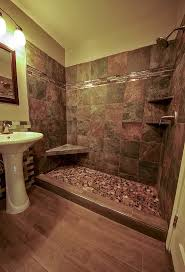 river rock shower and wood grained tile floor bathroom remodel in