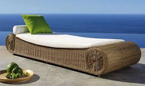Modern Patio Furniture With White Lather And Green Cushion On Wicker Bench Near Blue Sea View