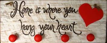 Home Is Where You Hang Your Heart Crafted From Two Pieces Of Wood And Has A Whitewash Distressed Look With Dark Brown Lettering Red Cut Out