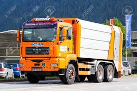 TYROL, AUSTRIA - JULY 29, 2014: Orange Garbage Truck MAN TGA.. Stock ... Garbage Trucks Orange Youtube Crr Of Southern County Youtube Man Truck Rear Loading Orange On Popscreen Stock Photos Images Page 2 Lilac Cabin Scrap Vector Royalty Free Party Birthday Invitation Trash Etsy Bruder Side Loading Best Price Toy Tgs Rear Ebay