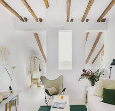 Modern Furnishings In Loft With White Walls And Floor Exposed Beamed Ceilings Spain
