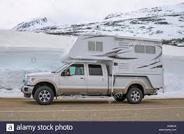 Pickup Truck Camper On A Road With Snow In The Background Stock ... Building A Truck Camper Home Away From Home Teambhp Truck Camper Turnbuckles Tie Downs Torklift Review Www Feature Earthcruiser Gzl Recoil Offgrid Inspirational Pickup Trucks Campers 7th And Pattison Corner Adventure Lance Rv Sales 9 Floorplans Studebaktruckwithcamper01jpg 1024768 Pixels Is The Best Damn Diy Set Up Youll See Youtube Diesel Vs Gas For Rigs Which Is Better Ez Lite How To Align Before Loading