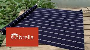 Video Of Sunbrella Cooper Navy Awning Stripe Fabric 4987 0000 ... Sunbrella Awning Stripe 494800 Sapphire Vintage Bar 46 Fabric 494600 Blacktaupe Fancy Video Of Yellow White 6 5702 Colonnade Juniper 4856 46inch Striped And Marine Outdoor Forest Green Natural 480600 Awnings Porch Valances Home Spun Style This Awning Features Westfield Mushroom Milano Charcoal From Fabricdotcom In The