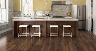 Hickory Laminate Flooring Menards by Pergo Wood Flooring Xp Burnished Caramel Oak 8 Mm Thick X 712 In