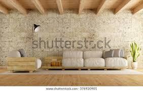 modernes wohnzimmer mit palettensofa steinwand und