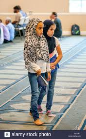 wearing a hijabs or head scarves two muslim girls wait for the