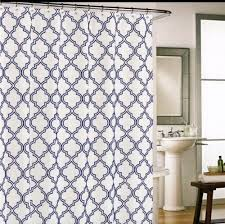 cynthia rowley moroccan tile quatrefoil navy blue on white fabric