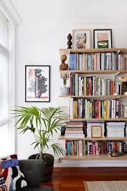 DECORATING IDEAS The Best Little Apartment Bookshelf With Colorful Books And House Plant