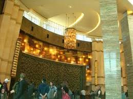 MGM Grand Foxwoods Check in Area that is a waterfall behind the