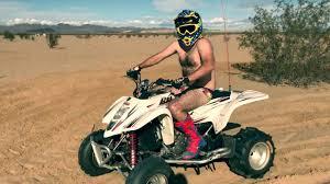 GUY RIDES ATV QUAD DRESSED IN UNDERWEAR |