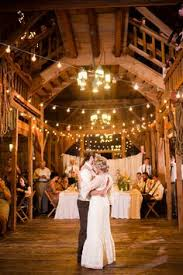 String Lights Over Wooden Dance Floor Western WeddingsRustic WeddingsWedding LightsRustic Wedding DecorationsDance