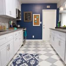 Gray And White Checkered Floor In Navy Kitchen