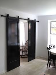 The Little House In The City: Apartment Renovation: Barn Door Solution White Sliding Barn Door Track John Robinson House Decor How To Epbot Make Your Own For Cheap Knotty Alder Double Sliding Barn Doors Doors The Home Popsugar Diy Youtube Rafterhouse Porter Wood Inside Ideas Best 25 Interior Ideas On Pinterest Reclaimed Gets Things Rolling In Bathroom Http Beauties American Hardwood Information Center Design System Designs Tutorial H20bungalow