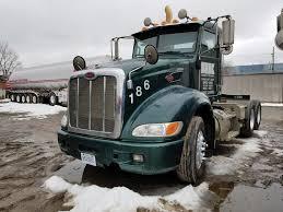 100 Mckinley Trucking 2010 PETERBILT 386 TA TRUCK TRACTOR DAY CAB VIN 1XPHD49X0AD793744