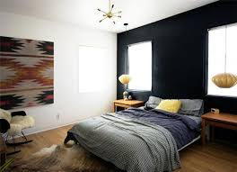 Add Some Bohemian Flair To Your Black Bedroom By Decorating One Of Walls With A Colorful Patterned Piece