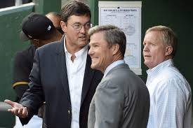 Pirates Owner Bob Nutting Talks With President Frank Coonelly And General Manager Neal Huntington In The