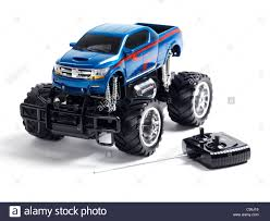 Radio Controlled Toy Monster Truck With A Remote Control Isolated On ... Webby Remote Controlled Rock Crawler Monster Truck Blue Buy Amazoncom Ford F150 Svt Raptor 114 Rtr Rc Colors New Bright Ff Jam Bursts Grave Digger 112 24g 2wd Alloy High Speed Control Off 124 Scale Maxd Walmartcom Electric Redcat Volcano18 V2 118 Mons Rc Trucks Suppliers And Manufacturers At Big Hummer H2 Wmp3ipod Hookup Engine Sounds Shop 4wd Triband Offroad C2035 Cars 30mph Control Brushed Gizmo Toy Ibot Road Racing Car Monster Truck Toys Array