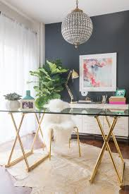 A modern and girly office space with chic furniture and accessories