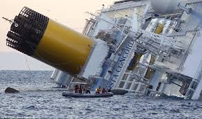 costa concordia wreck which saw deaths of 32 when it sank is towed
