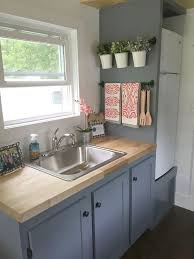 In The Galley Kitchen Are Blue Grey Cabinets Butcher Block Counters A Four
