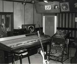 Black And White Photograph Of A Recording Studio Dominated By Large Mixing Desk
