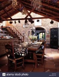 100 Rustic Ceiling Beams Wooden Table And Chairs In Dining Area Of Large