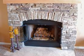 Living Room With Fireplace And Bookshelves by Stone Fireplace Design Providing Warmth For Living Room