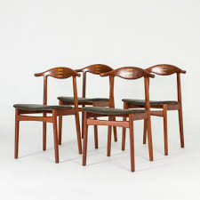 Set Of Four Dining Chairs By Knud Færch Four Ding Chairs In Stain Beech Teak Upholstered With Black Leatherette Art Nouveau Or Deco Shield Back Antique Ding Chairs Set Of Vintage Four By Helge Sibast For Early 19th Century Round Bdmeier Table Moes Home Collection Calvin Sadlers Johannes Andersen Denmark Circa 1950 Victorian Walnut The Shop Fashionchrystal Setfour Includedtransparent 5 Pc Counter Height Room Setpub And 4 East West Fniture Mid Modern Lawrence Peabody