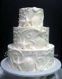 Elegant Beach Themed White Butter Cream Wedding Cake With Shells Scrolls And Beads By Graceful Creations