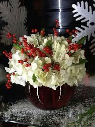 Festive Centerpiece That Is Elegant But Easyand Inexpensive To Douses White Carnations And Contrasting Red Berries