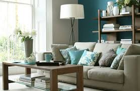 interior blue lake house turquoise living room gray and