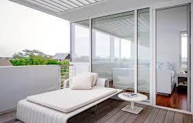 FurnitureMinimalist Balcony Design With White Minimalist Deck Feat Cushions Near Round