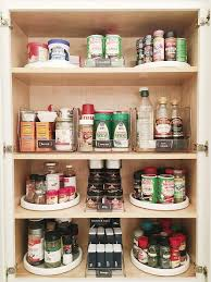 Kitchen Pantry Cabinet Filled with Lazy Susan Spice Racks