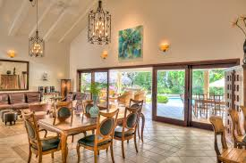 4 The Expansive Living Dining Room With Vaulted Ceilings Opens Onto A Covered Terrace And Pool Patio Which Is One Of Most Distinctive Aspects This