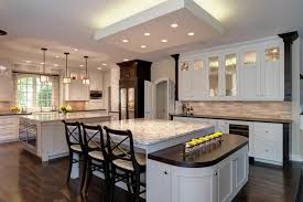 Massive Open Design Kitchen Holds Two Immense Marble Topped Islands Foreground Example Features Large