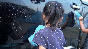 Asia Little Girl Wash A Car With Family Together, Slow Motion Shot ...