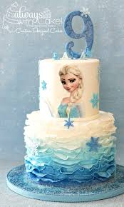 s really hard to do something original for the Frozen theme Everyone wants the same thing Fondant ruffles and sparkly snowflakes made this cake simple