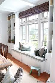 the dining room window seat window hang photos and storage