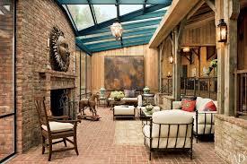 Rustic Living Room With Columns Herringbone Tile Floors Chandelier Pendant Light