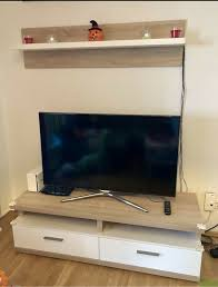 wohnzimmer wohnwand tv bank regal eiche beleuchtung möbel kraft