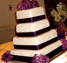Elegant White Square Wedding Cake Decorations Matched With Lovely Purple Ribbon And Beautiful Purple Wedding